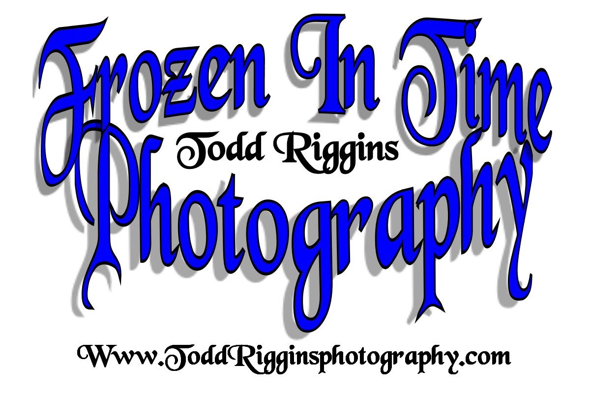 Todd Riggins Logo white background blue letters