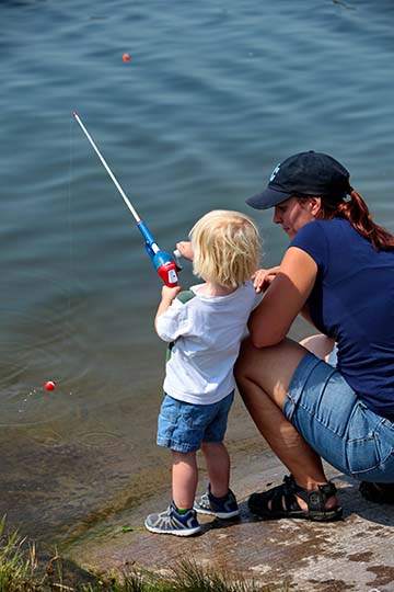 mom and boy fishing